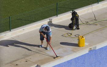 brush the pool walls and steps
