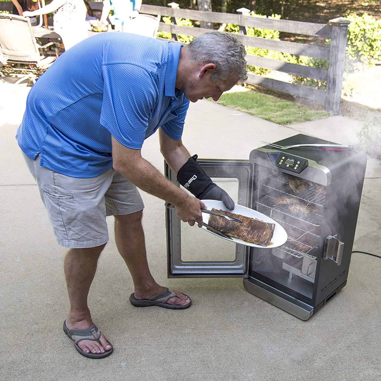 man grilling in a char-broil smoker