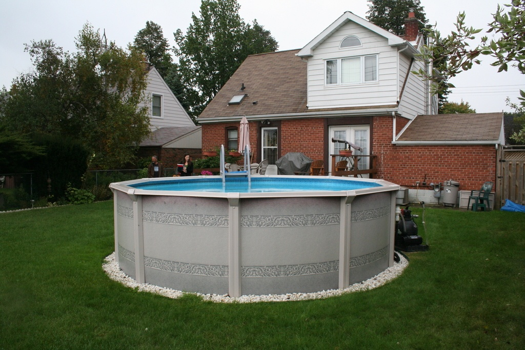 above ground pool on grass